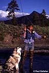 Fly fisherman and dog