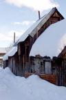 Snow covers a historic shed in one of Crested Butte's back alleys