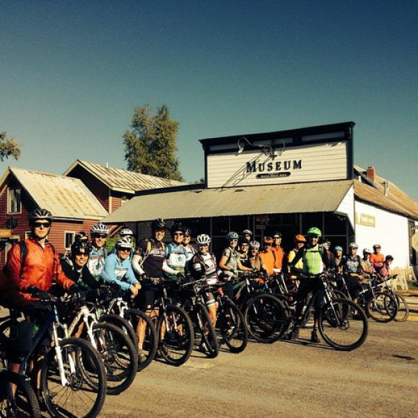 Cyclists gathering at the Crested Butte Heritage Museum for the 38th Pearl Pass Tour to Aspen…All gather to hear directions first by The legendary Don and Kay Cook! Mr. Don Cook leading the way.